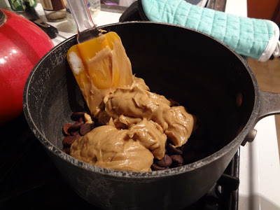 Peanut butter and chocolate chips in the pot
