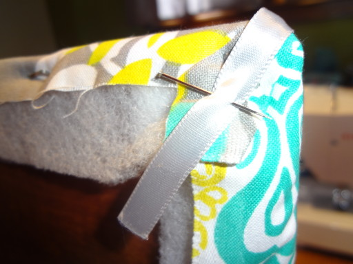 Pin ribbon to the back.